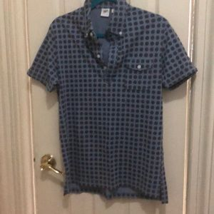 Blue patterned pull over golf shirt